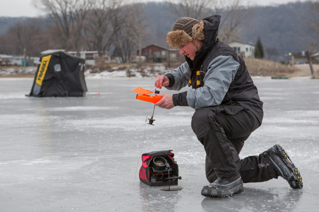 An insulated Pro Thermal ice fishing tip-up prevents the hole from refreezing.