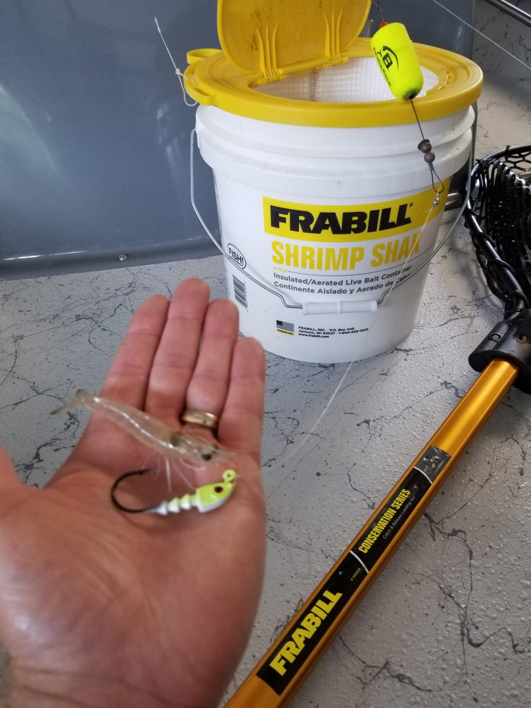 Keep brown shrimp lively in the Frabill Shrimp Shak for a successful fishing trip.